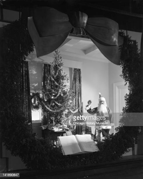 Window Display of Santa Claus at Marshall Field Company Santa by the Christmas tree Chicago Illinois December 2 1944