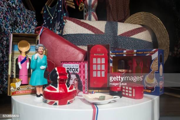 Window display of tacky British monarchy memorabilia and kitsch souvenirs