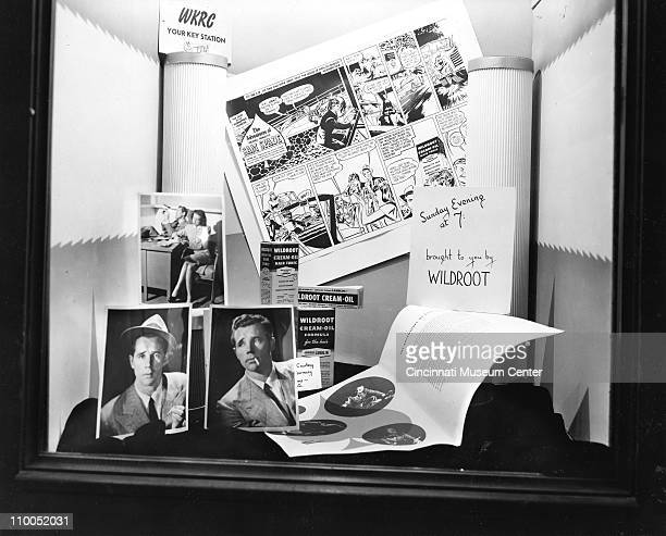 Window display promotes the weekly radio broadcast of 'The Adventures of Dashiell Hammett's Sam Spade' sponsored by Woldroot brand hair tonic on WKRC...