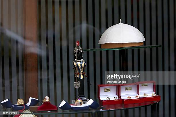 Window display showing the future Pope's skullcap, a statue representing a Swiss Guard and rings worn by Cardinals, are seen in shop of Stefano...