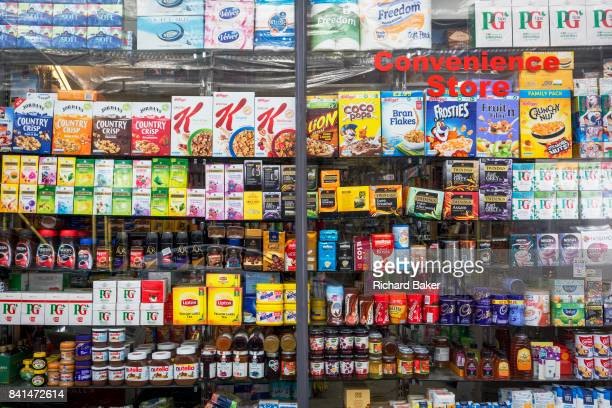 Window display showing the retail products being sold in a Kensington convenience store on 31st August 2017 in London England