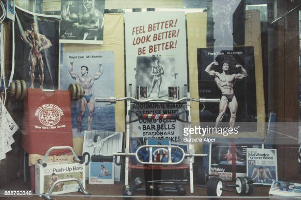 A window displaying gym equipment photographs of bodybuilders and memorabilia New York City circa 1980