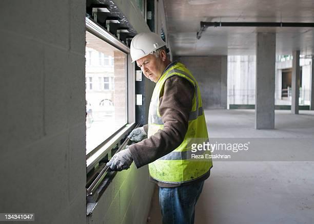 Window fitter adjusting window trim