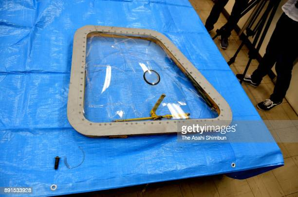 A window frame which fell from a US CH53 helicopter is seen at Ginowan Police Station on December 13 2017 in Ginowan Okinawa Japan A metal window...