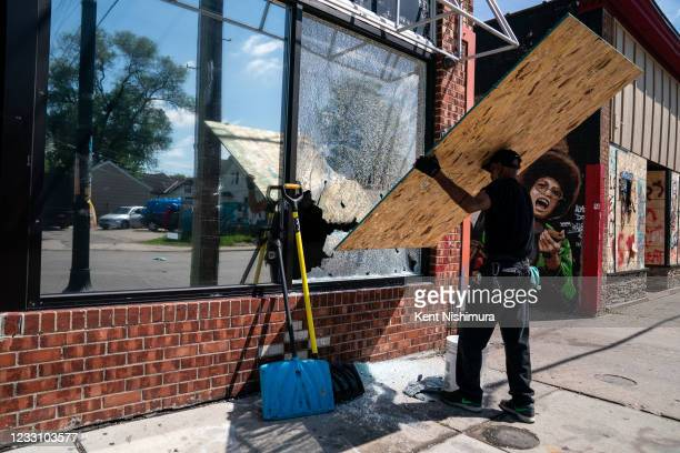 Window hit by gunfire this morning is boarded up at Prestige Cuts Barber Shop near the George Floyd Memorial Square on Tuesday, May 25, 2021 in...