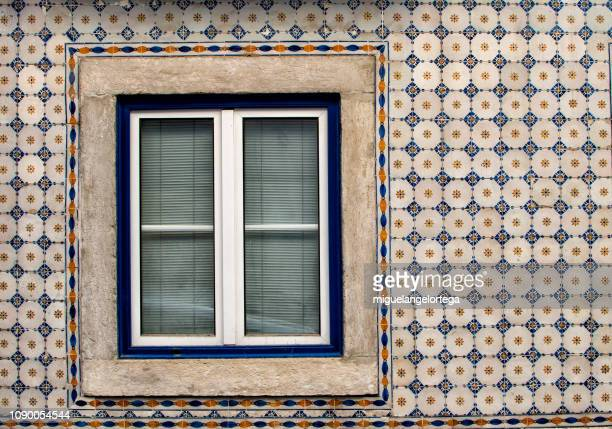 window in a facade decorated with tiles - portuguese culture stock pictures, royalty-free photos & images