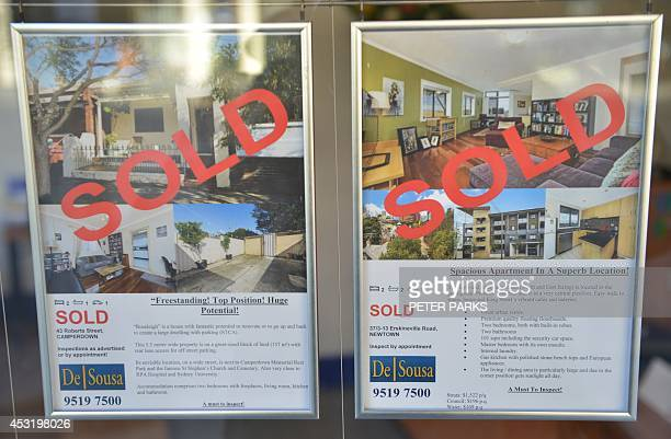 A window in a real estate agents shows properties whch are all sold in Sydney on August 5 2014 Australia's central bank held interest rates at a...