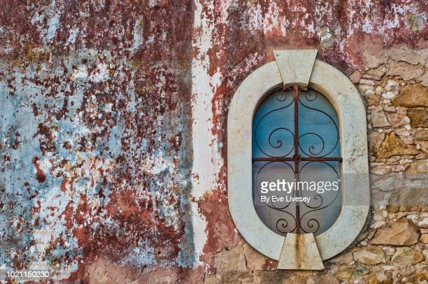 window in faro old town - faro city portugal stock photos and pictures