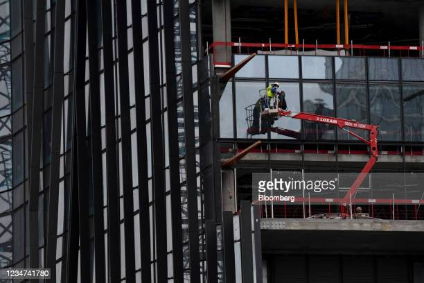 Window installation work during the restructuring of the Aurore Tower in the La Defense business district in Paris, France, on Wednesday, Aug. 18,...