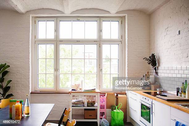 Window into sunny white European kitchen