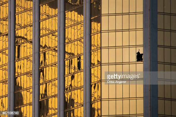 A window is broken on the 32nd floor of the Mandalay Bay Resort and Casino where a gunman opened fire on a concert crowd on Sunday night October 3...