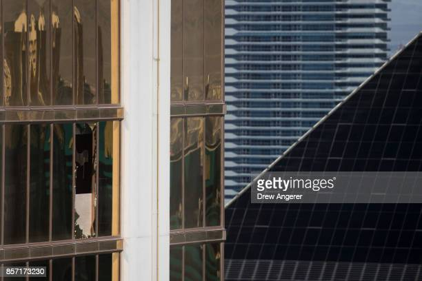 A window is broken on the 32nd floor of the Mandalay Bay Resort and Casino where a gunman opened fire on a concert crowd during a mass shooting at...