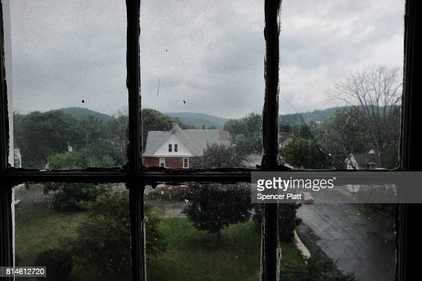 A window looks out on a street in the struggling city of Williamsport which has recently seen an epidemic of opioid use among its population on July...