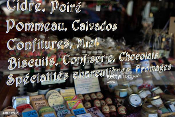window of a shop in honfleur selling products from normandy - calvados stock pictures, royalty-free photos & images