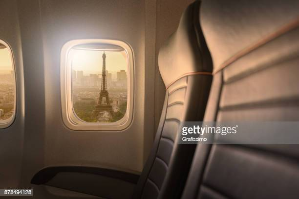 Window of airplane with sight to Eiffelturm in Paris