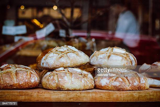 Window of bakery with bread