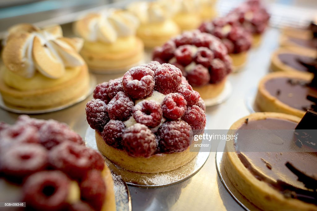 Window of desserts at a pastry shop : Stock Photo