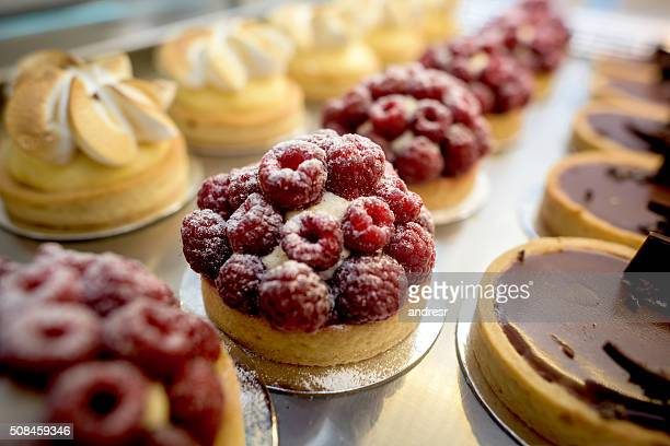 window of desserts at a pastry shop - sweet food stock pictures, royalty-free photos & images
