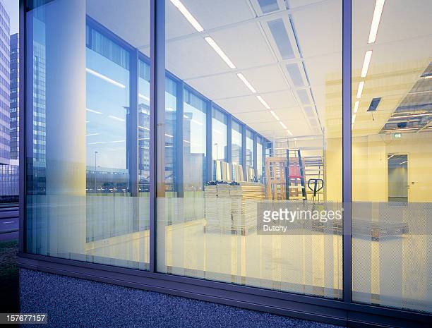 window of newly built empty office space. - recessed lighting stock pictures, royalty-free photos & images