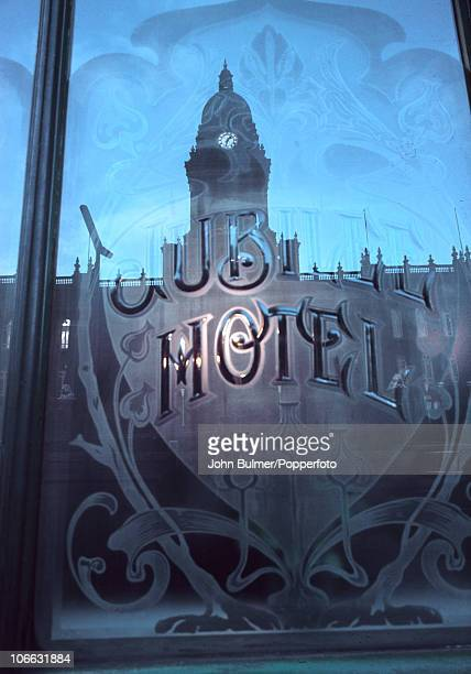 A window of the Jubilee Hotel in Leeds with a reflection of the Town Hall opposite circa 1964