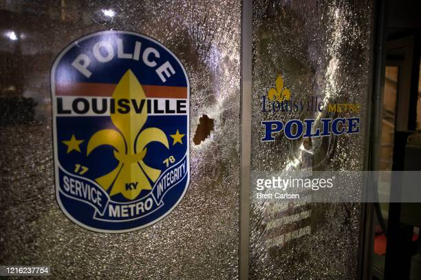 Window of the metro police headquarters damaged during protests is seen on May 29, 2020 in Louisville, Kentucky. Protests have erupted after recent...