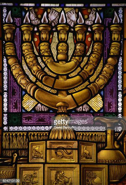 A window of the Rabbinate Synagogue depicts a menorah one the symbols of Judaism in stained glass Jerusalem Israel | Location Rabbinate Synagogue...