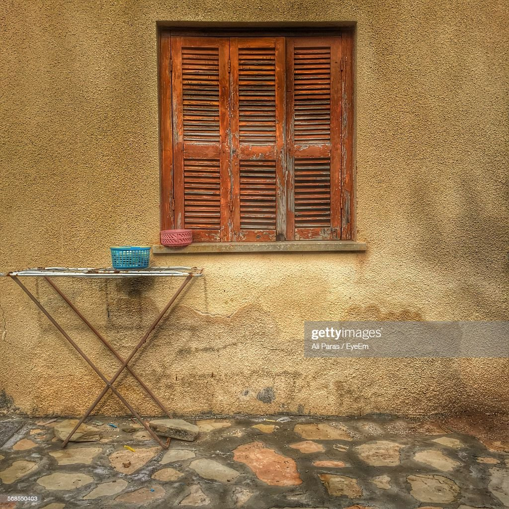 Window On Building By Street : Stock Photo