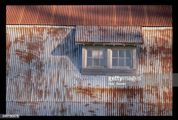 A window on the roof of a cannery building in Alaska