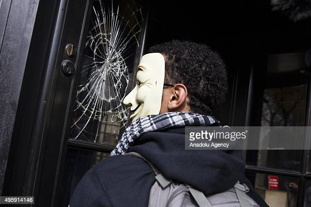 Window pane at the Environmental Protection Agency was accidentally broken when protestors were banging on the doors during the Anonymous Million...