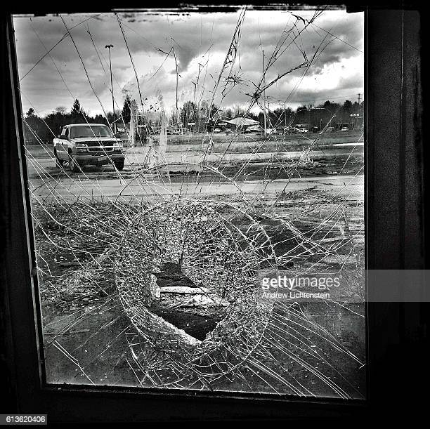 Window remains broken in the abandoned Apollo shopping mall which sits on the western edge of the struggling town on March 25, 2016 in Monticello,...