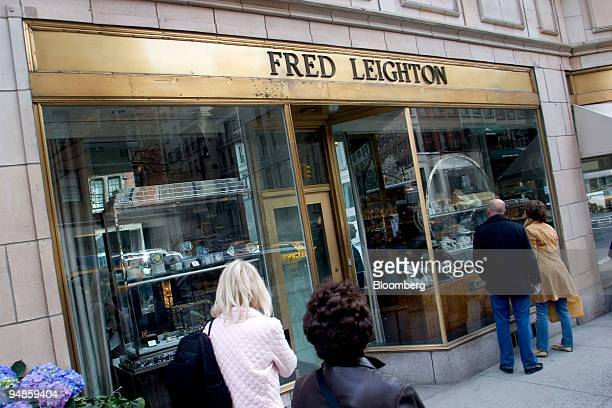 Window shoppers look at jewelry on display at the Fred Leighton store in New York, U.S., on Friday, April 11, 2008. Patrician fourth-generation...