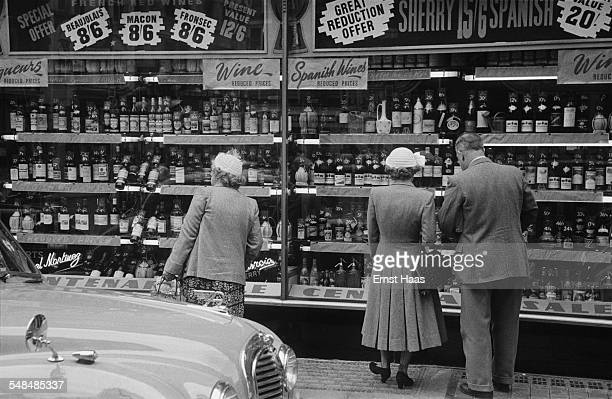 Window shopping at a wine merchants in Mayfair London circa 1953