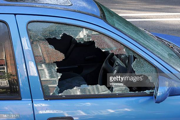 Window smashed by car thief street scene