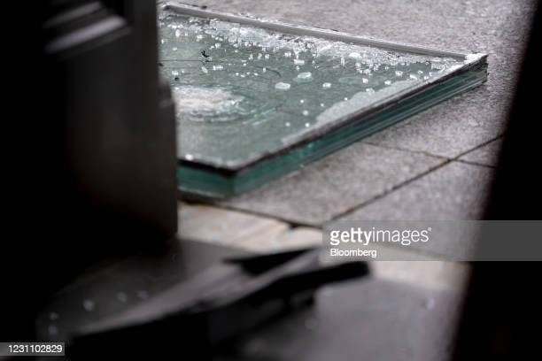 Window that had been broken in the January 6 riots on the ground at the U.S. Capitol in Washington, D.C., U.S., on Thursday, Feb. 11, 2021. House...