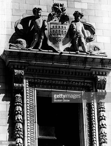 Window treatment on the south end of the Tremont Street Baptist Church in Boston features an elaborate coat of arms complete with cherub supporters,...