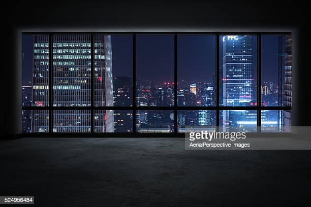 Window View of an Illuminated Beijing Skyline