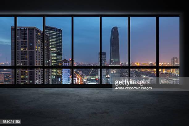 Window View of an Illuminated City Skyline