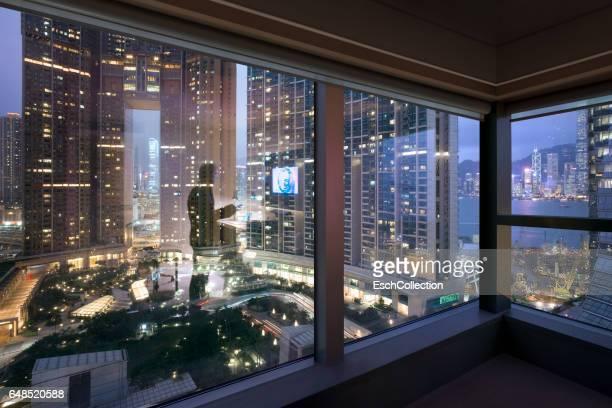 Window view of an illuminated skyline of Hong Kong