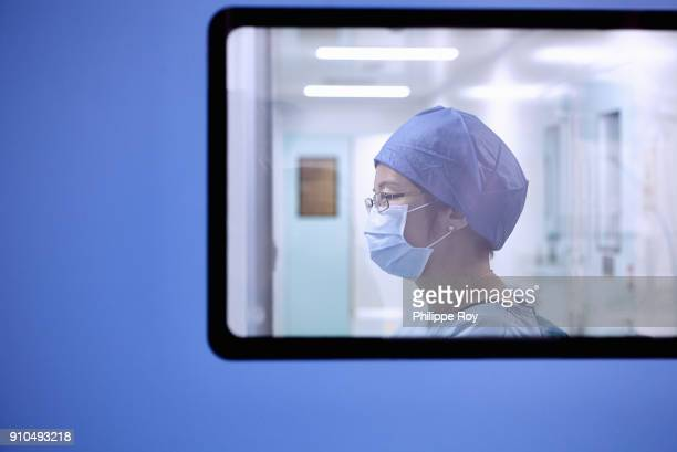 Window view of two female surgeon in maternity ward operating theatre