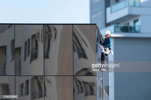 window washer of skyscrapers - high up stock pictures, royalty-free photos & images