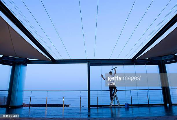 window washer - commercial cleaning stock photos and pictures
