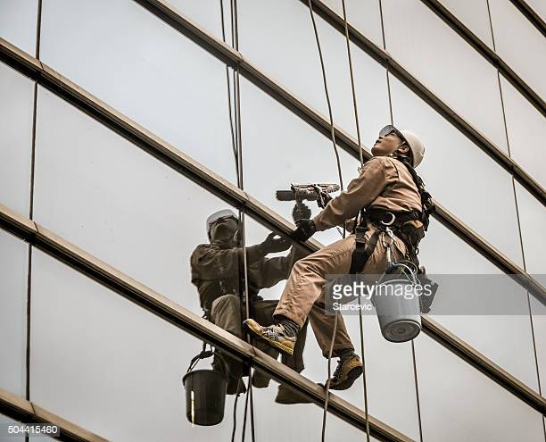 window washer - window cleaning stock photos and pictures