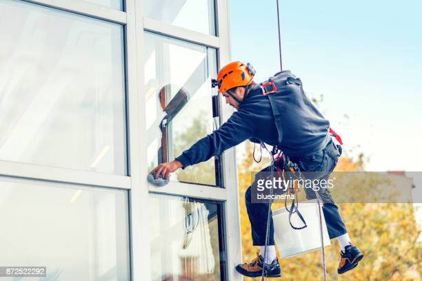 window washer - high up stock pictures, royalty-free photos & images