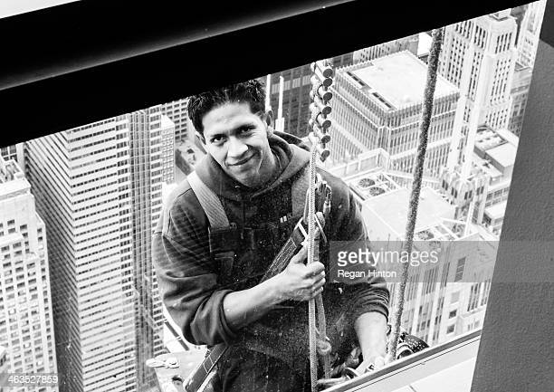 CONTENT] A window washer smiles for the camera while suspended on the 103rd floor of the Willis Tower