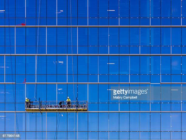 window washers cleaning - window cleaning stock photos and pictures