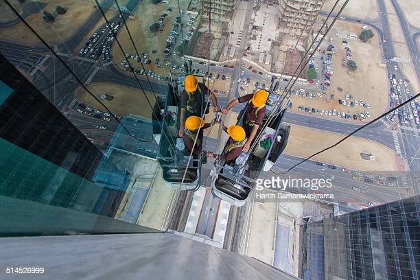 window washers in dubai - window cleaning stock photos and pictures