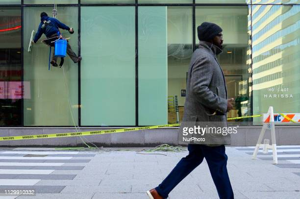 Window washers work on cleaning an office building in Center City Philadelphia PA on March 11 2019 Winter weather made place for more spring like...