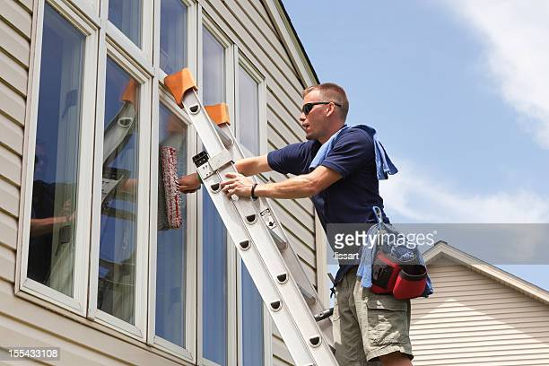 window washing professional - window cleaning stock photos and pictures