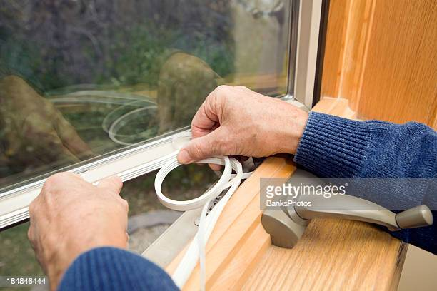 window weather seal application - energy efficient stock photos and pictures
