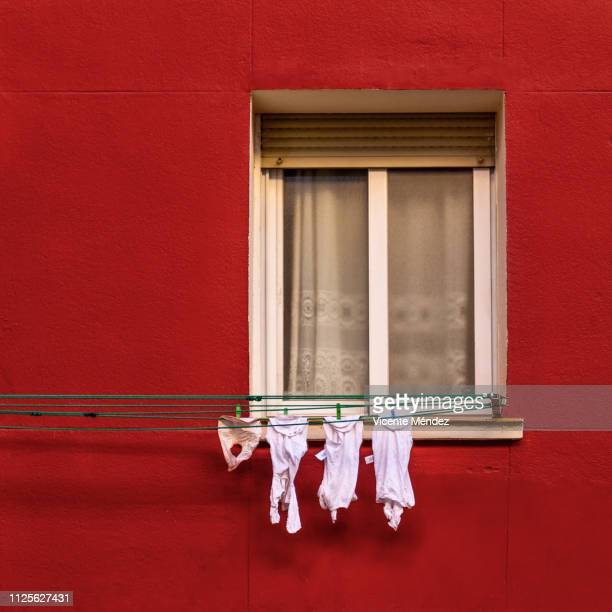 Window with baby clothes hanging